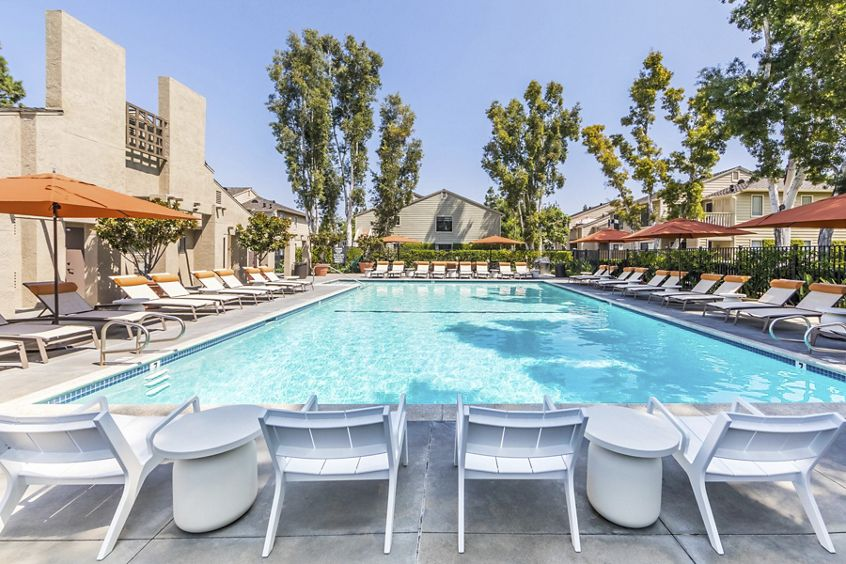 Exterior view of pool at Windwood Knoll Apartment Homes in Irvine, CA.