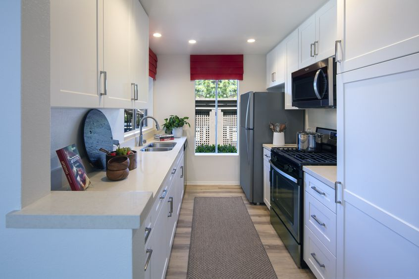 Interior view of kitchen at Woodbridge Pines Apartment Homes in Irvine, CA.