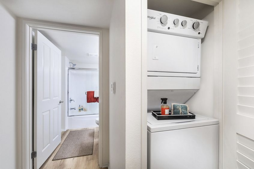 Interior view of laundry room at Woodbridge Pines Apartment Homes in Irvine, CA.