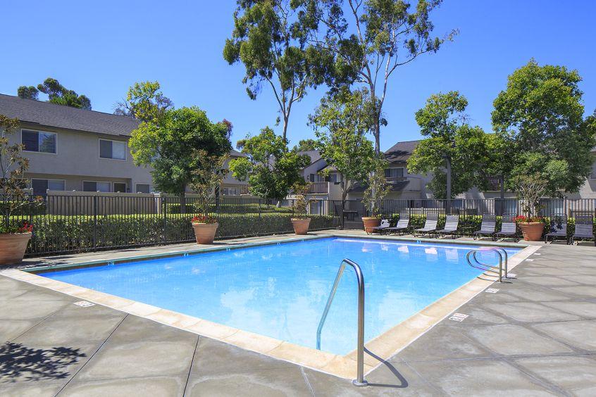 Exterior view of pool at Woodbridge Villas Apartment Homes in Irvine, CA.