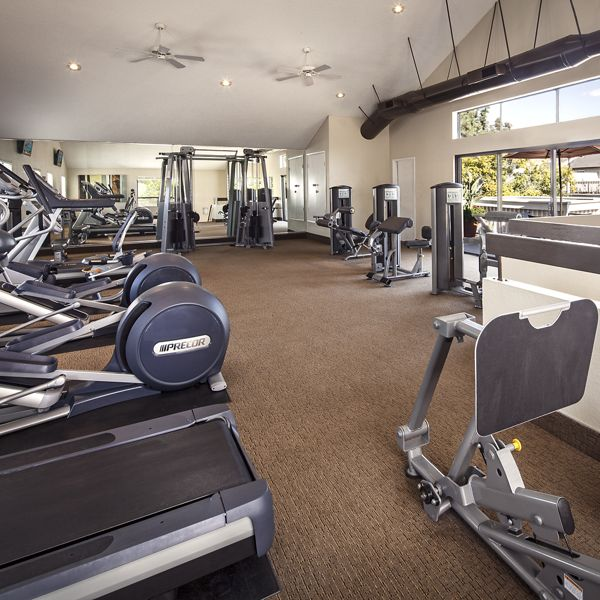Interior view of fitness center at Woodbridge Villas Apartment Homes in Irvine, CA.