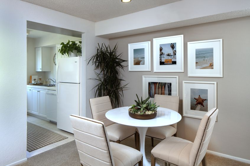 Interior view of dining room and kitchen at Woodbridge Villas Apartment Homes in Irvine, CA.
