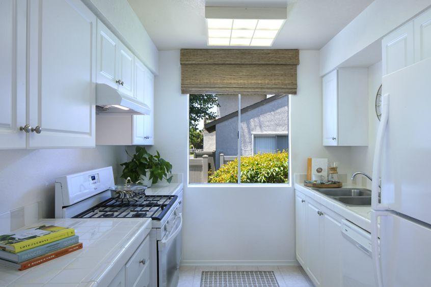 Interior view of kitchen at Woodbridge Villas Apartment Homes in Irvine, CA.