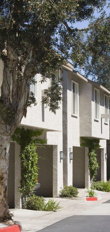 Exterior view of Woodbridge Villas Apartment Homes in Irvine, CA.