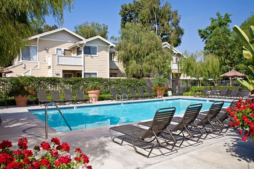 Exterior view of pool at Woodbridge Willows Apartment Homes in Irvine, CA.
