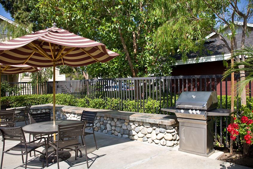 Exterior view of barbecue patio at Woodbridge Willows Apartment Homes in Irvine, CA.