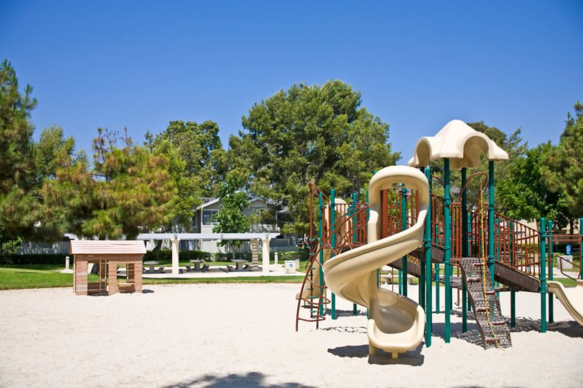Exterior view of playground at Woodbridge Willows Apartment Homes in Irvine, CA.