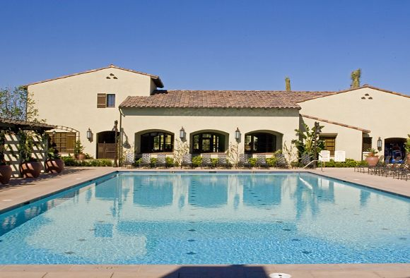 Exterior view of pool at Woodbury Court Apartment Homes in Irvine, CA.