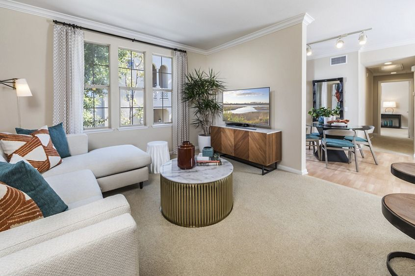 Interior view of living room and dining room at Woodbury Lane Apartment Homes in Irvine, CA.
