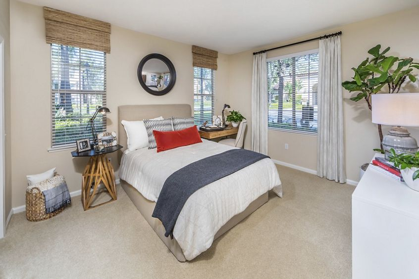 Interior view of bedroom at Woodbury Lane Apartment Homes in Irvine, CA.