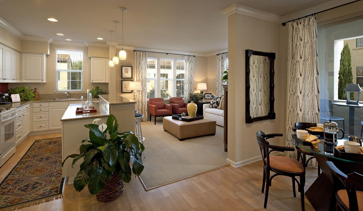 Interior view of kitchen and living room at Woodbury Lane Apartment Homes in Irvine, CA.
