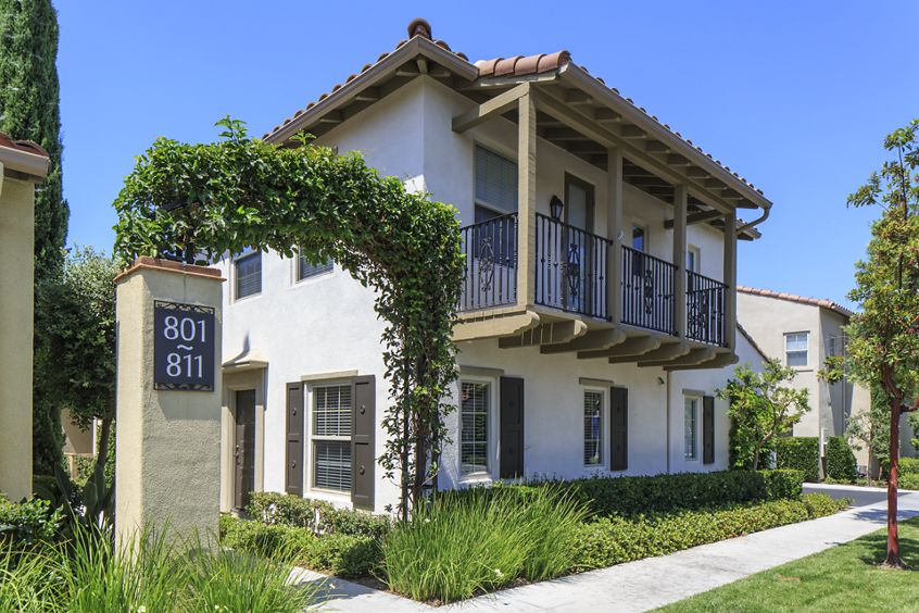 Exterior view of Woodbury Place Apartment Homes in Irvine, CA.