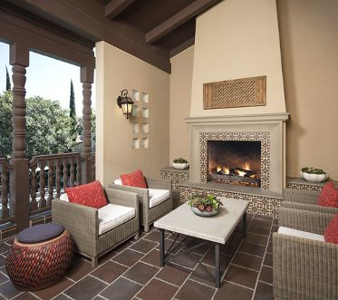 Outdoor Fireplace and lounging area at Woodbury PLace Apartment Homes in Irvine, CA
