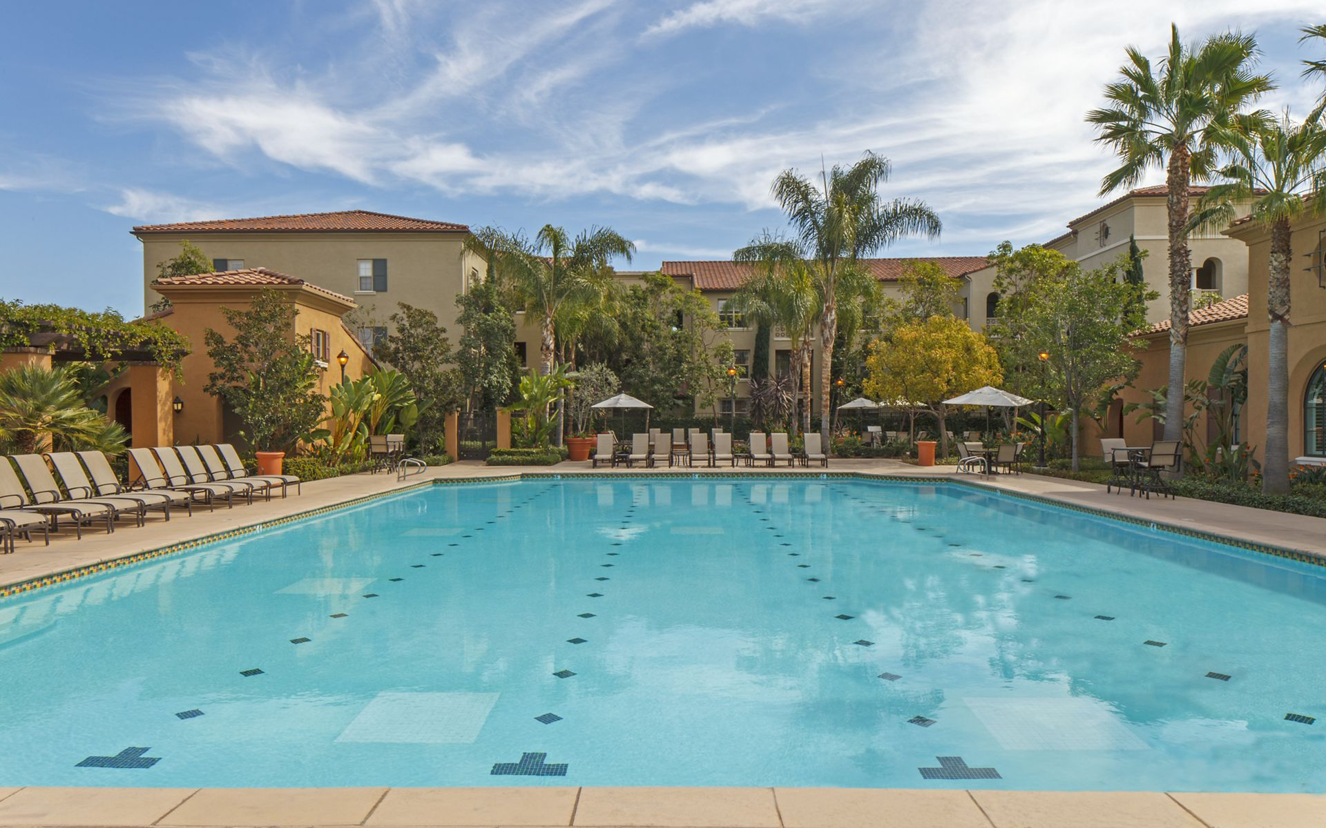 Exterior view of pool at Woodbury Square Apartment Homes in Irvine, CA.