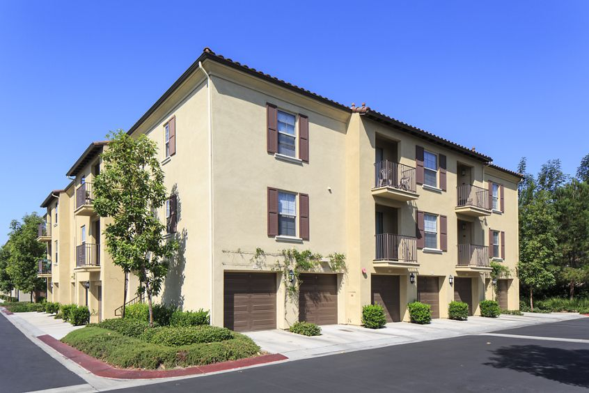 Exterior view of Woodbury Square Apartment Homes in Irvine, CA.