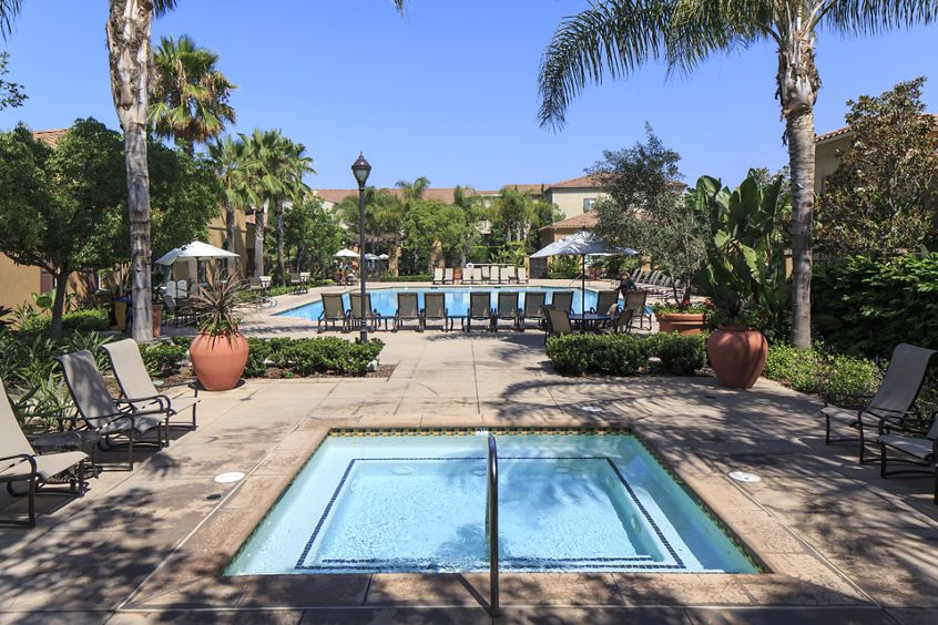 Exterior view of pool and spa at Woodbury Square Apartment Homes in Irvine, CA.