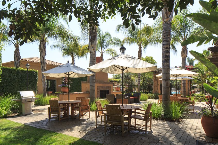 Exterior view of barbecue patio at Woodbury Square Apartment Homes in Irvine, CA.