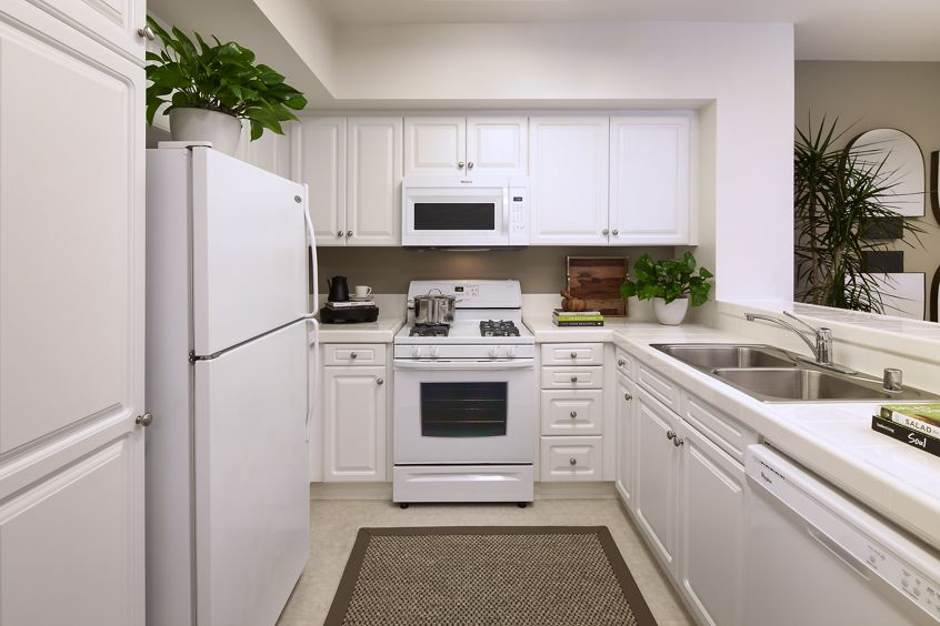 Interior view of kitchen at Woodbury Square Apartment Homes in Irvine, CA.