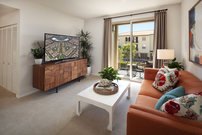 Interior view of living room at Woodbury Square Apartment Homes in Irvine, CA.