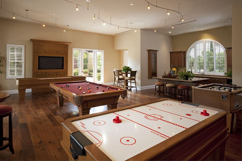 Interior view of game room at Woodbury Square Apartment Homes in Irvine, CA.