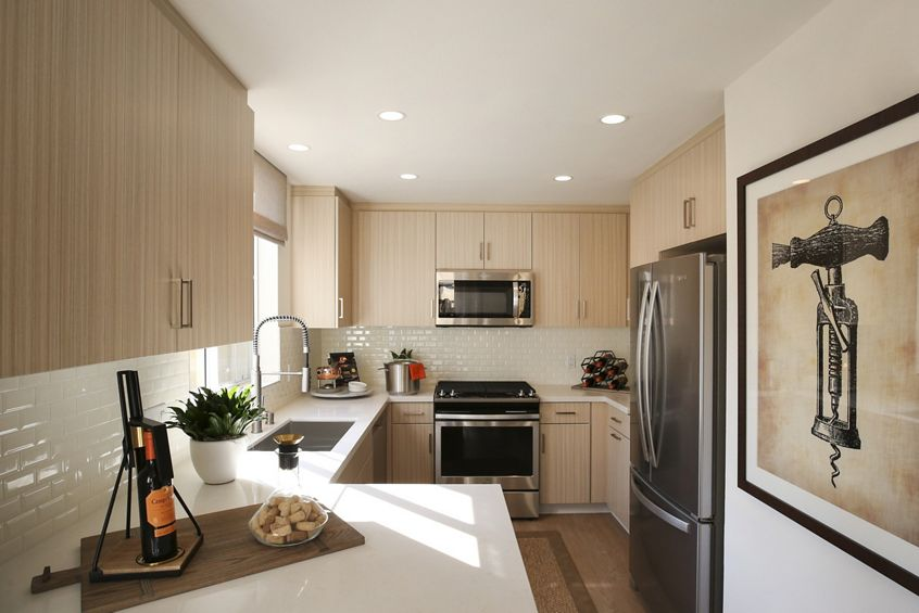 Interior view of kitchen at Baypointe Apartment Homes in Newport Beach, CA.