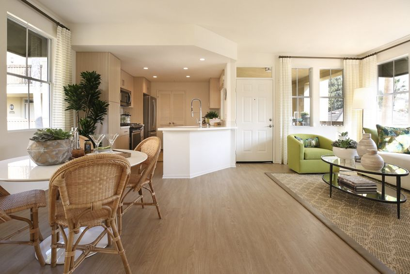 Interior view of living room and dining room at Baypointe Apartment Homes in Newport Beach, CA.