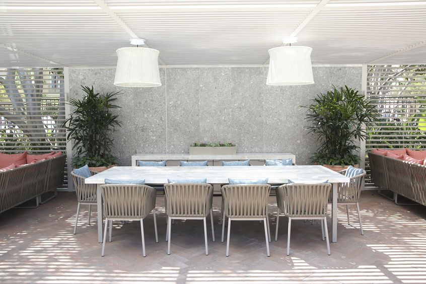 Exterior view of outdoor dining seating at Baypointe Apartment Homes in Newport Beach, CA.