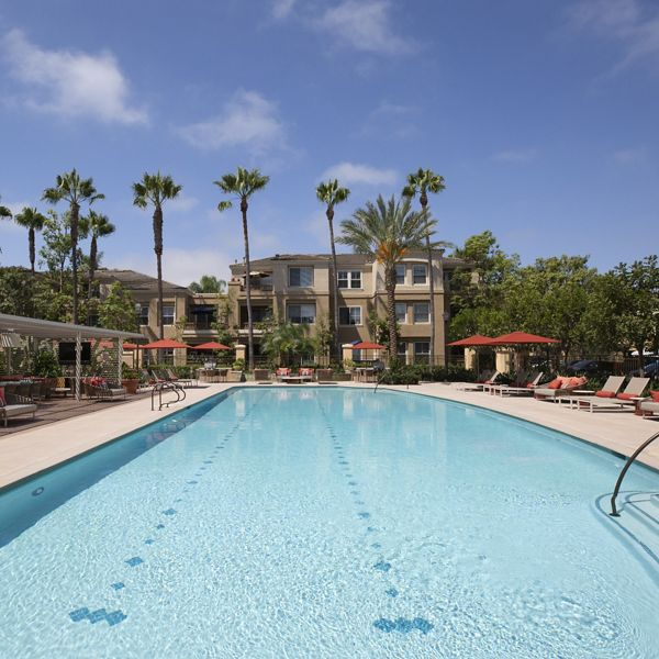 Exterior view of pool at Baypointe Apartment Homes in Newport Beach, CA.