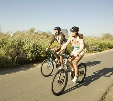 Baypoint Apartment Homes Photo Shoot: Couple riding bikes on pathway. Mitchell 2008.