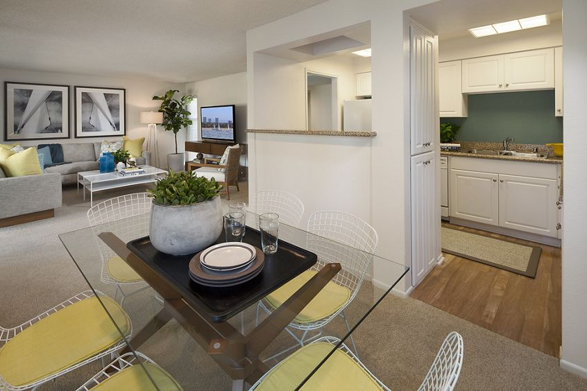 Interior view of living area and kitchen at The Bays Apartment Homes in Newport Beach, CA.