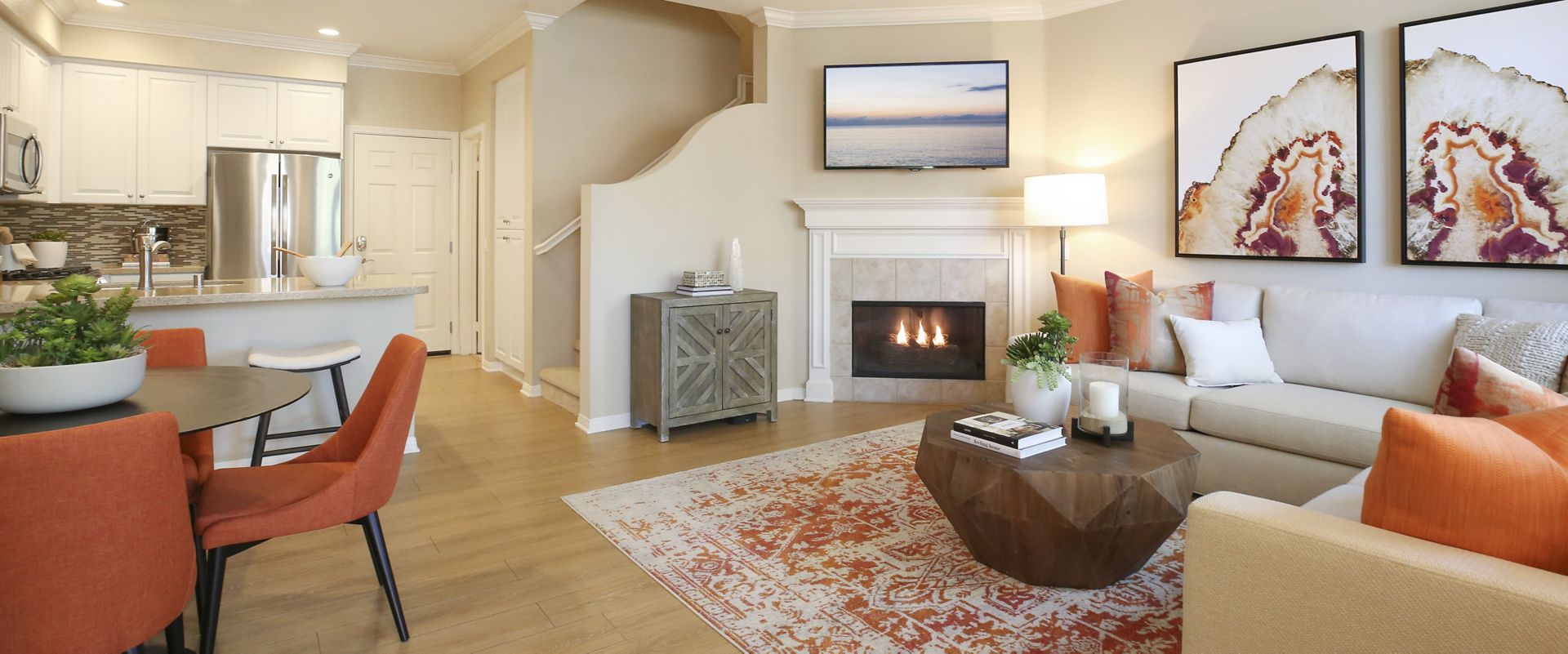 Interior view of living room and dining room at Bordeaux Apartment Homes in Newport Beach, CA.
