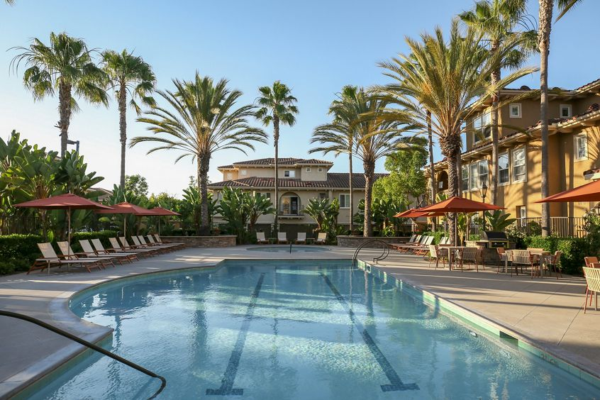 Exterior pool view at Newport Bluffs Apartment Homes in Newport Beach, CA.