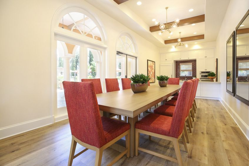 Interior view of dining room in clubhouse at Newport Bluffs Apartment Homes in Newport Beach, CA.