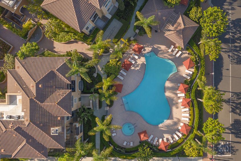 Exterior aerial view of pool and spa at Newport Bluffs Apartment Homes in Newport Beach, CA.