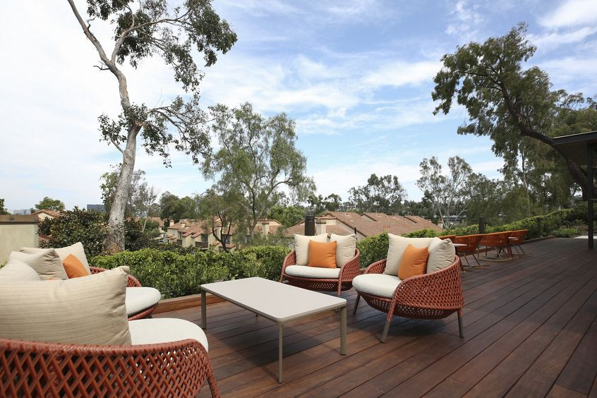 Exterior view of outdoor seating at Newport North Apartment Homes in Newport Beach, CA.