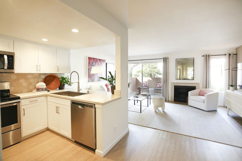 Interior view of kitchen and living room at Newport North Apartment Homes in Newport Beach, CA.