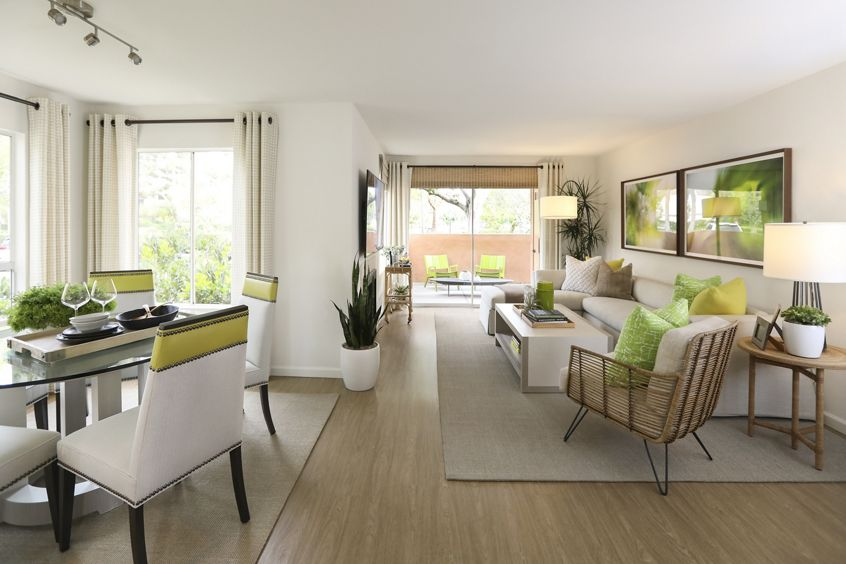 Interior view of living room and dining room at Newport North Apartment Homes in Newport Beach, CA.