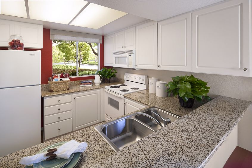Interior view of a kitchen at Newport North Apartment Homes in Newport Beach, CA.