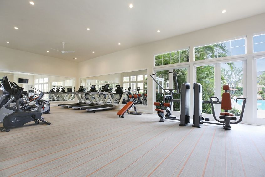 Interior view of fitness center at Newport Ridge Apartment Homes in Newport Beach, CA.