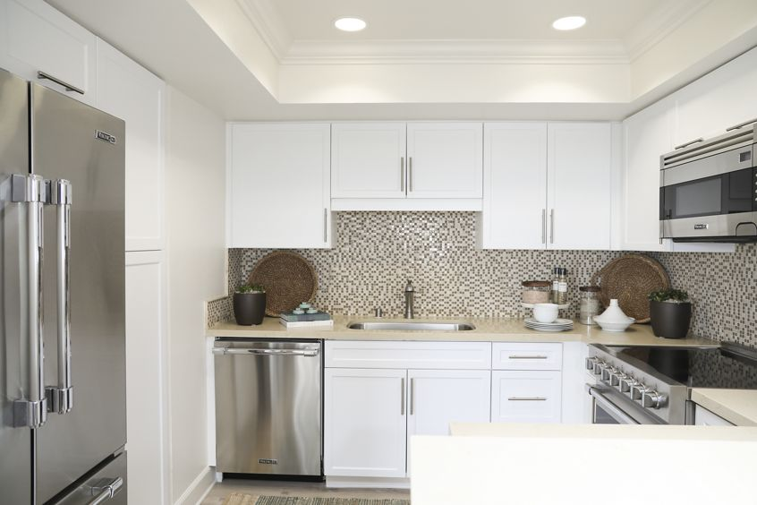 Interior view of kitchen at Promontory Point Apartment Communities in Newport Beach, CA.
