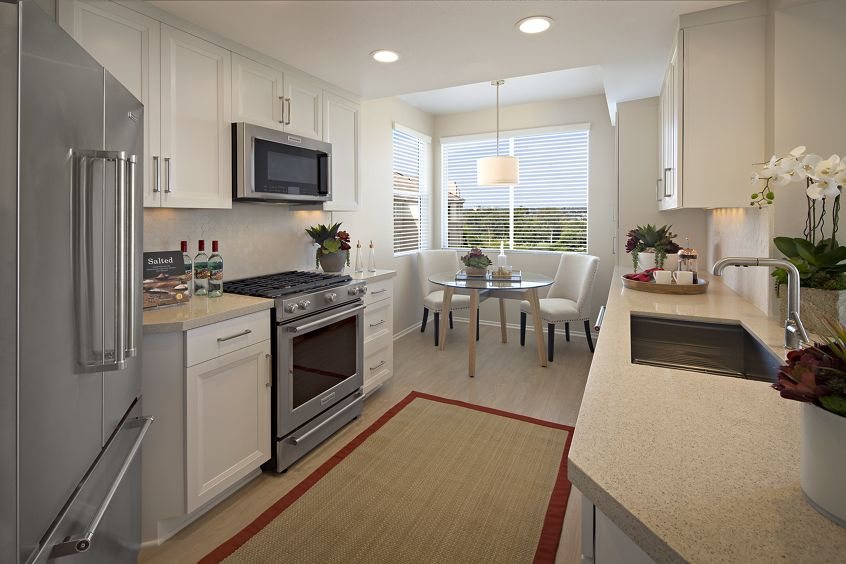 Interior view of kitchen and dining room at The Colony at Fashion Island Apartment Homes in Newport Beach, CA.