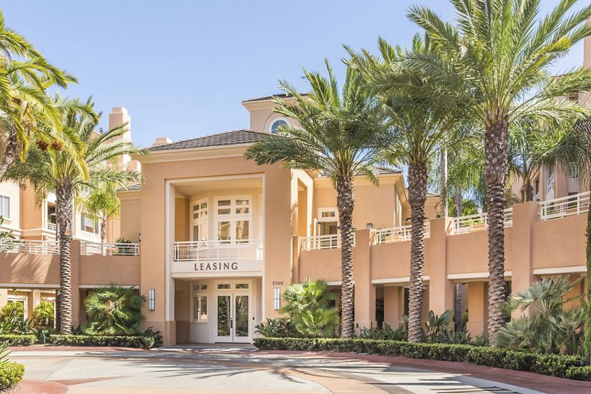 Exterior view of leasing center at The Colony at Fashion Island Apartment Homes in Newport Beach, CA.