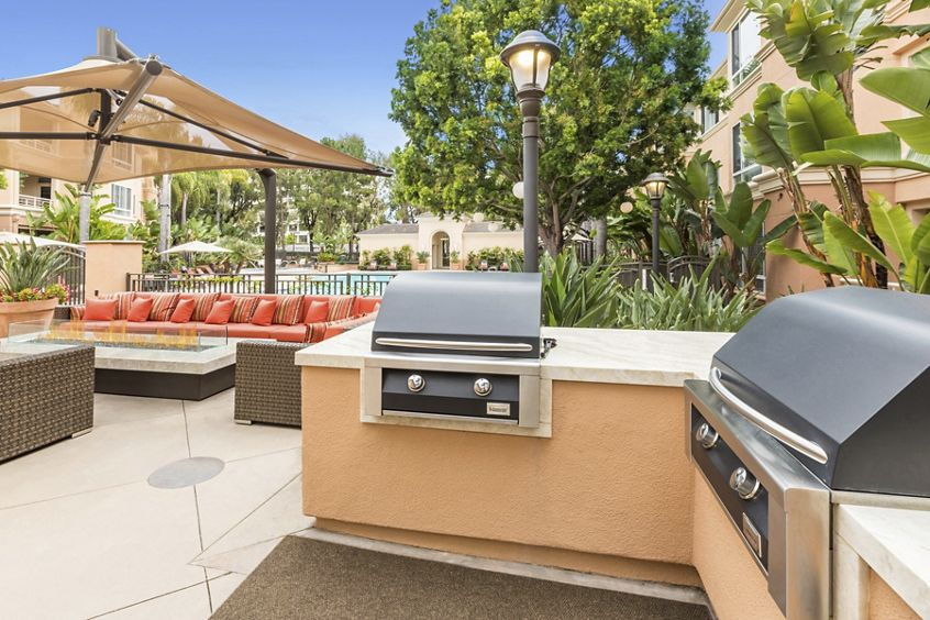Exterior view of outdoor BBQ and patio The Colony at Fashion Island Apartment Homes in Newport Beach, CA.