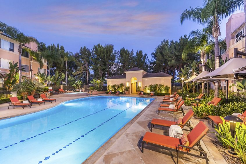 Exterior dusk view of pool at The Colony at Fashion Island Apartment Homes in Newport Beach, CA.