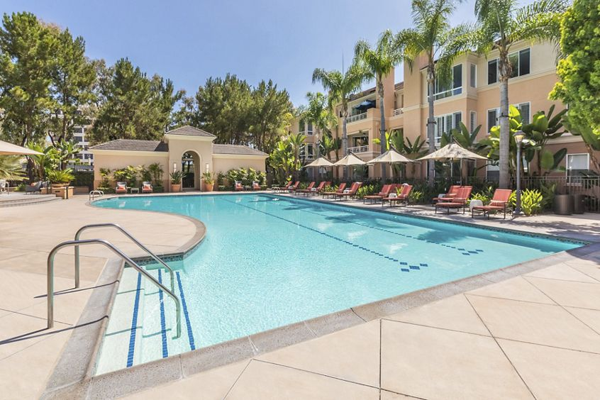 Exterior pool view at The Colony at Fashion Island at Apartment Homes in Newport Beach, CA.