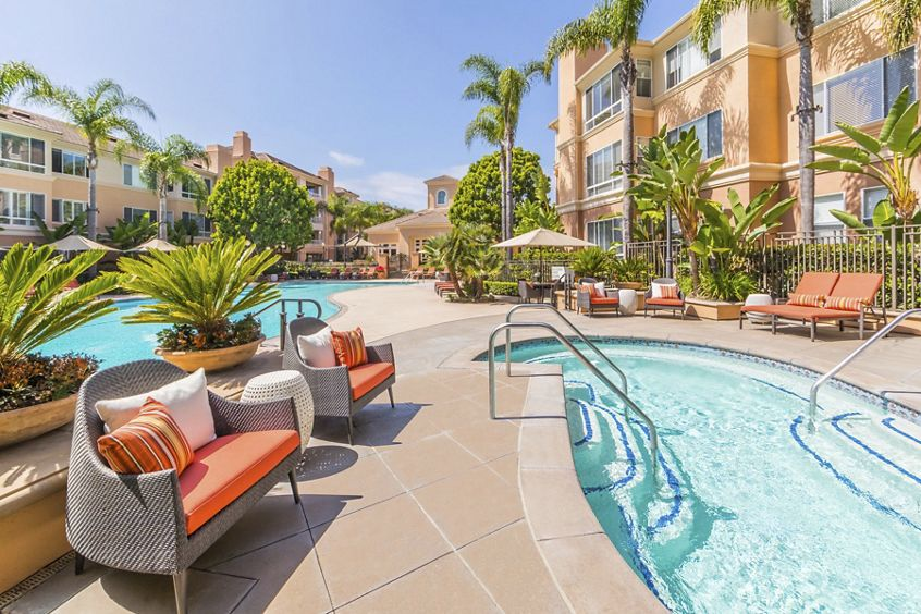 Exterior view of pool and spa at The Colony at Fashion Island at Apartment Homes in Newport Beach, CA.