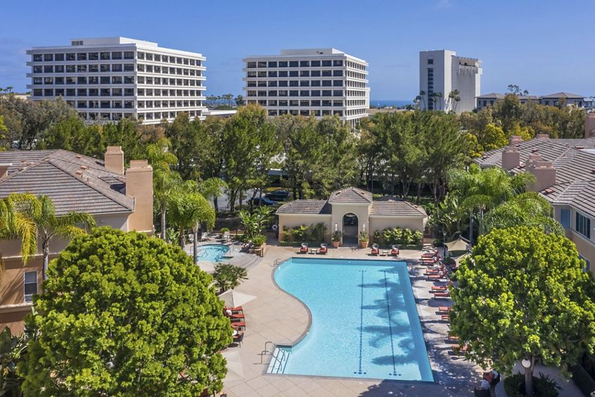 Exterior aerial view of pool at The Colony at Fashion Island at Apartment Homes in Newport Beach, CA.