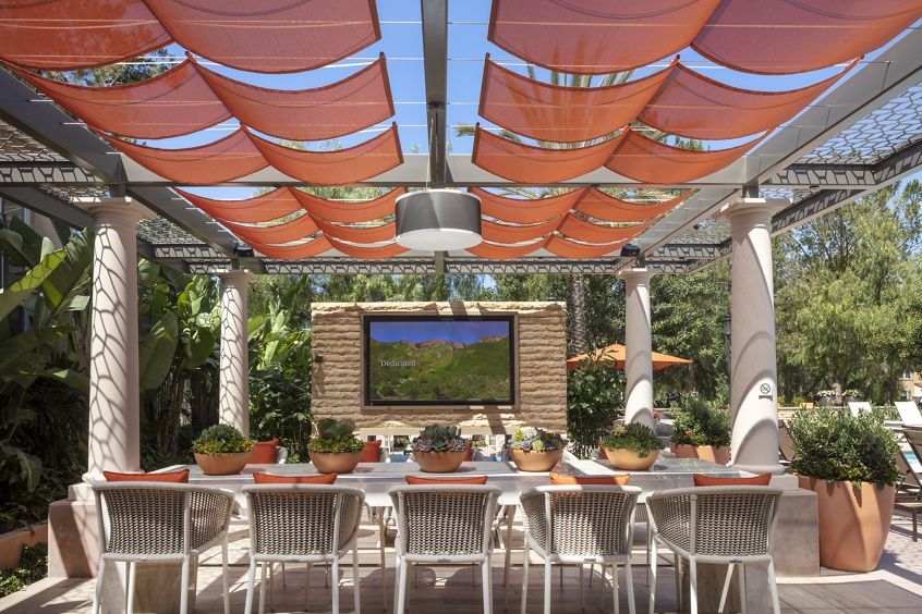 View of outdoor patio at Turtle Ridge Apartment Homes in Newport Beach, CA.