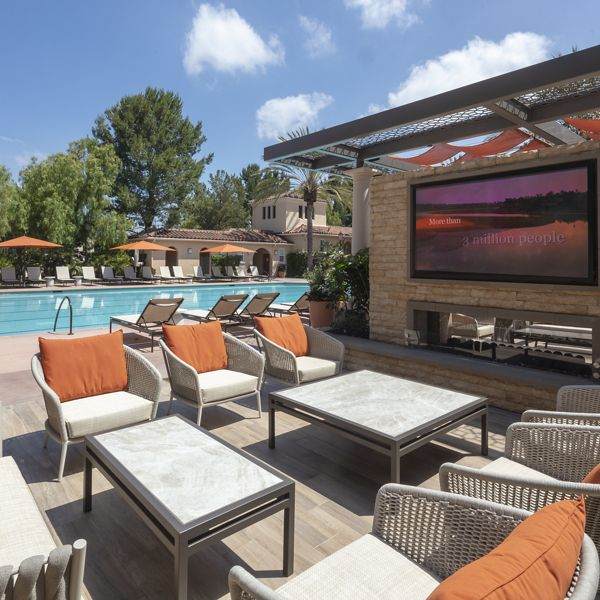 View of patio and pool at Turtle Ridge Apartment Homes in Newport Beach, CA.