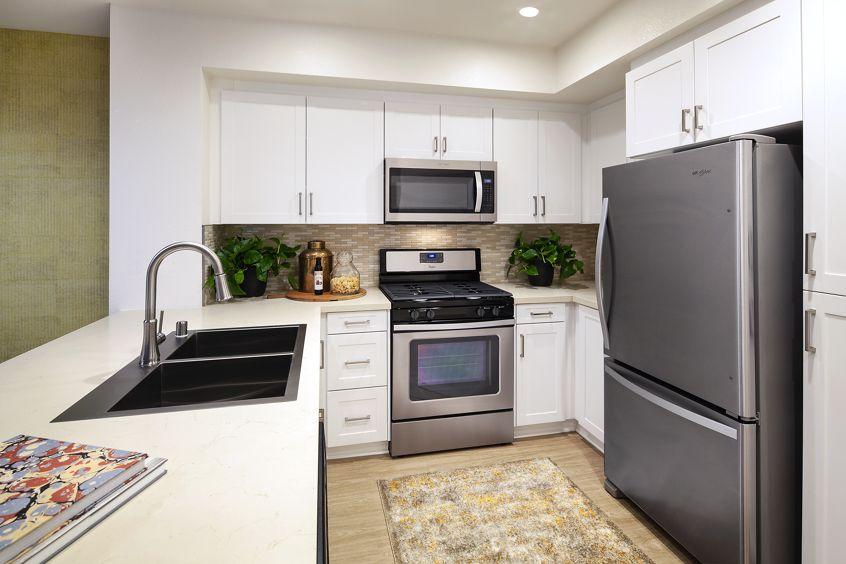Interior view of kitchen at Turtle Ridge Apartment Homes in Newport Beach, CA.